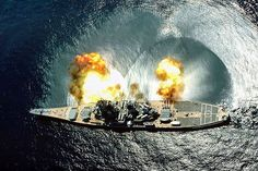 USS Iowa (BB-61) fires a full broadside of her nine 16/50 and six 5/38 guns during a target exercise near Vieques Island Puerto Rico.