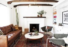 leather-sofa-brass-chandelier, round table, cactus