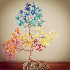 Origami leaves. Birds, butterflies or other insects are a good theme to go with trees.