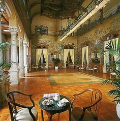 Salon Basile, Villa Igiea, Palermo, Sicily. The 'Salone Basile' (see picture) is to one side of the hotel's long main corridor. This chamber is quite enchanting for the art nouveau paintings by De Maria Bergler.