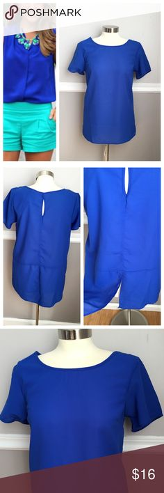 NWT blue top Bright blue short sleeve shirt. Small keyhole on back and split fabric on back. Great for work or to go out! 100% polyester. First photo on left not actual item * just showing for style! BUNDLES 20% off  Japna Tops