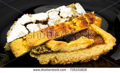 Slices of three different homemade tarts and pie on a black dish. For food concepts