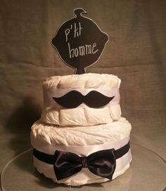 Gâteau de couches pour la naissance d'un garçon imaginer la version fille