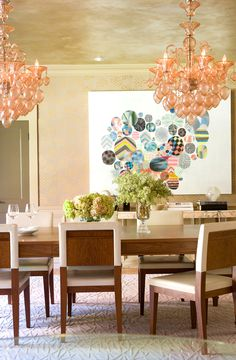 Feminine chandeliers in colorful dining room