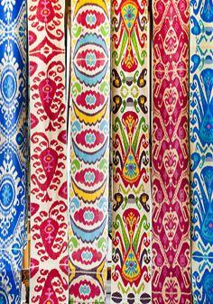 Uzbekistan, Fergana area... uzbek silk ikat textiles. Tying The Clouds
