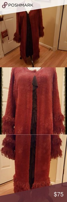"""BEAUTIFUL BURGUNDY MOHAIR SWEATER COAT Midi sweater coat done in a soft cozy burgundy mohair that falls to the middle of the calf. Worn w/ boots or shoes, this baby is an attention grabber! Inches of matching fringe hang from the sleeves & bottom. The sleeves measure 19"""" w/ 3"""" of fringe. The length from the back of neck to bottom is 34"""" w/ an additional 5"""" fringe adding to a total of 39"""" long. This was a gift from Nordstrom that has never been worn. The size tag is out b/c I planned on…"""
