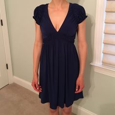 Beautiful short sleeve laundry dress Adorable, versatile indigo laundry dress. Super low maintenance. This dress does not wrinkle! Can be worn with a tank underneath for daytime or for a more conservative look. Very high quality. Laundry by Design Dresses