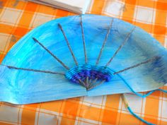 Weave a rainbow! Fun Rainbow Paper Plate Weaving Art and Craft Project for kids & Rainbow Paper Plate Weaving Project | Rainbows Craft and Craft ...