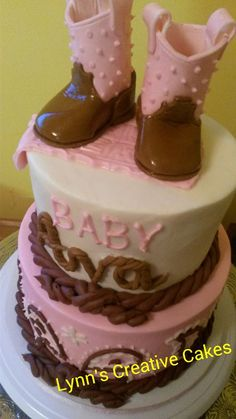 Pink cowboy boots baby shower cake