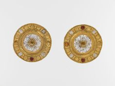 Pair of gold and rock crystal disks, set with garnet and glass inlays. Period: Late Archaic. Date: early 5th century B.C. Culture: Etruscan. Medium: Gold, rock crystal.