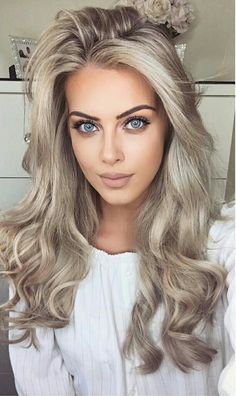 """Chloé Boucher - """"NEW YOUTUBE VIDEO! Big, bouncy hair tutorial, the link is in my bio! I'm wearing @foxylocks 20"""" clip-ins in Latte Blonde . Use code """"FoxyChloeB"""" at checkout for a free gift with your purchase  #makeup #foxylocks #hair #ad """""""