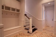 Mud room - love the brick floor and the idea of walking up steps to go in the house