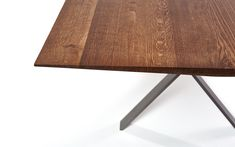 With the table from our LAX collection, a tobacco-colored steel frame bears a solid slab of smoked oak, which tapers towards the sides.