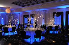 Love the blue up lighting at reception tables