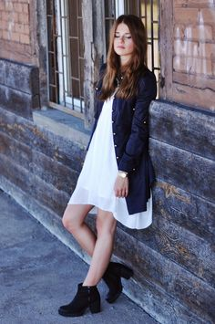 white dress with coat and boots