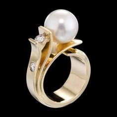 Fiore del Mare Ring by Adam Neeley. In Fiore del Mare ring design, a South Sea pearl blooms forth from graceful petals of gold. This unique ring design includes stunning South Sea pearl with diamond accents set in yellow gold. Unique Diamond Rings, Rose Gold Diamond Ring, Unique Rings, Sapphire Rings, Tahitian Pearl Ring, Unique Ring Designs, Vintage Rose Gold, Curved Wedding Band, South Sea Pearls
