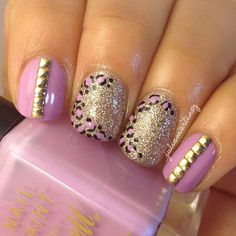 Purple nails with leopard print and studs