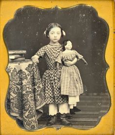 19th-century girl with papier mache doll