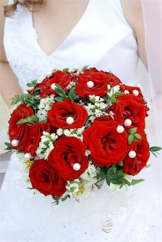 Bridal bouquet with red and ivory flowers
