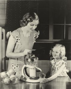 Yum! Woman and child test out a GE Electric Juicer in 1936.