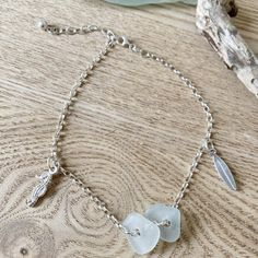 This gorgeous sterling silver and sea glass anklet from OMG SeaGlass Designs also features a seahorse and surf board charm and can also be worn as a bracelet. ~*~ #designerspotlight #featuredartist #madeitmaker #madeitmakers #madeitseller #featuredmaker #featureddesigner #madeitau #oceanjewellery #anklet #seaglass #seaglassjewellery #beachjewellery #surfwear #oceaninspired #recycledjewellery #seaglasshunting #seaglasslover