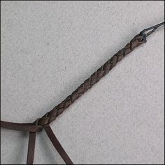 Four strand braid. Think I'm going to do this in cloth to make Sera a necklace.