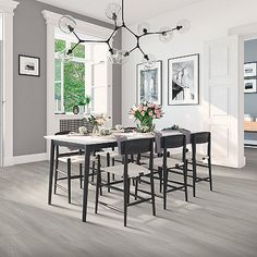 Grey, light wood-look flooring. Pergo Extreme Wider Longer in Soulful Grey