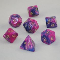 Bold, vibrant colors! Exciting twists, turns, and swirls! This toxic dice set has them all. Blue and pink colors are splashed together vigorously, with gold numbering. A set of seven polyhedral dice f