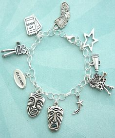 this charm bracelet features Hollywood/theater actor inspired tibetan silver charms (nickel free). the charms are attached to a silver tone chain bracelet that measures 7.5 inches in length.