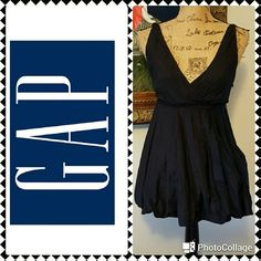 """Gap Black Bubble Hem Pleated Blouse In excellent condition.  Gap black cotton summer blouse. Bubble hem, pleated deep v-neckline in front and back, pleated band under bust. Measurements are length 26"""", bust 35"""". Longer top goes past hip. Would look great with skinny jeans. Gap Tops Tunics"""