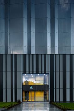 High Voltage Laboratory, northern Spain by ACXT Architects :: Crinkled polished metal wraps around electrical testing facility