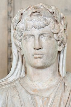 Ancient Roman marble Portrait of Antinous (AD 112–130) as a priest of the imperial cult. Found in Cyrene, Libya