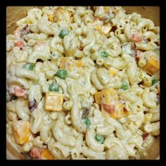 Bacon Cheddar Ranch Pasta Salad 3 cups uncooked macaroni 1 cup frozen peas and carrots 1 small onion, diced 6-8 strips bacon, cooked and diced 1 - 1-oz. packet Ranch dressing mix 1-1/2 cups Miracle Whip 1-1/2 cups mayonnaise 1 - 8-oz. package block cheddar cheese, cubed