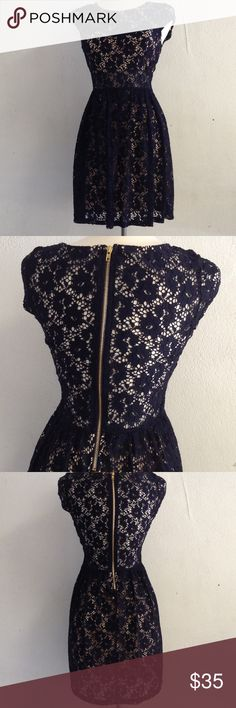 Navy lace Nude lining Dress navy lace  nude lining  gold tone zipper 90% nylon 10% spandex  lining 100% polyester Bailey blue  Dresses