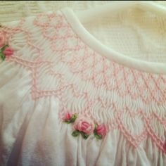 This pink smocking with bullion ribbon roses is just beautiful.  It has been years since I smocked anything but I love the craft!