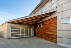 Frosted glass garage door, steel and wood beams, a steel door, wood siding, and Viroc siding