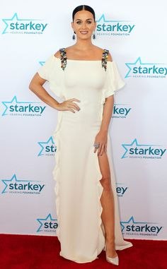 Katy Perry goes glam in a crisp white Chloé gown with a ruffled slit and jeweled shoulders.