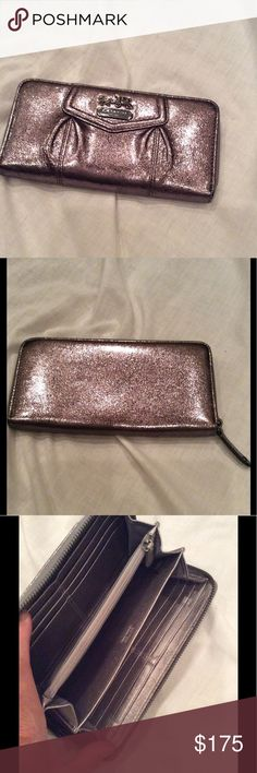 Coach envelope wallet Beautiful coach wallet in metallic pewter. 12 credit card slots. Zippered coin compartment and bill compartment. Authentic coach in as new condition. Very little use. Matching purse can be seen in my closet! Coach Bags Wallets