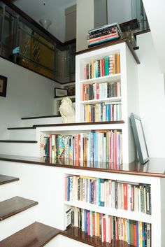 Book nook on stairs- I like how that one step is the shelf.
