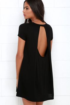 With a dress as eye-catching as the Made You Look Black Swing Dress, we don't blame you for doing a double take! Black stretch knit shapes a classic rounded neckline and short sleeves while a draping open back dresses up the swing bodice, finished with a rippling hem.