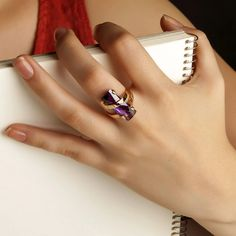 A stunning contemporary cocktail/statement ring comprising of a chunk of purple Quartz set in a modern gold design. #cocktail rings #statement rings #modern rings #contemporary design #purple quartz #purple jewellery #purple jewelry #gold rings #gifts for her Purple Quartz, Purple Gold, Purple Flowers, Purple Jewelry, Purple Fashion, Cocktail Rings, Statement Rings, Ring Designs, Solid Gold