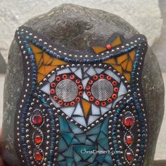 """Turquoise and orange glass along with multicolored turquoise beads and silver ball chain. Pewter swirly eyes, surrounded by Orange beads. Little orange bow. 6"""" x 81/2"""" x 2"""""""