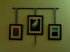 Hang pictures from a rod with ribbon