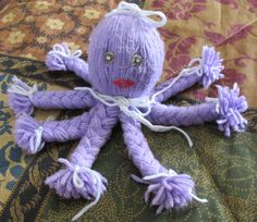 Worsted weight yarn octopus with braided legs..made many years ago for my granddaughter and well used as you can see by the picture..lol...