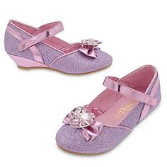 Rapunzel Costume Shoes for Kids | Disney Store They'll be able to walk in the footsteps of their favorite Disney Princess when wearing these glamorous Rapunzel Costume Shoes for Kids. The shimmering uppers feature a metallic bow topped by a large faceted heart jewel.