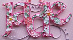 Made by Cecelia Louie/Paper Zen. Namesake piece made of quilled paper; flowers are glued upon hand cut letter and set above a cupcake swirled background.