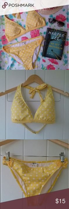 Classic Yellow Polka Dot Halter Top Bikini It's time to hit the beach, and this classic Yellow Polka Dot Bikini will be your new go-to! Classic and chic, this Next by Athena Halter Top Bikini is in very nice used condition with no noticeable defects. Top is a 36B/C and bottom is a Medium.   Now is the perfect time to bundle and save!  Offers welcome!  Any questions, just ask!  Happy Poshing! Next by Athena Swim Bikinis
