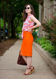 Pair a bright floral tank with a bright skirt, love the orange