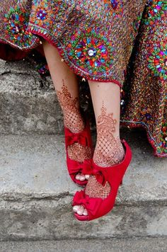 somehow all these elements are in harmony :: henna feet + red bow heels + rainbow spattered skirt
