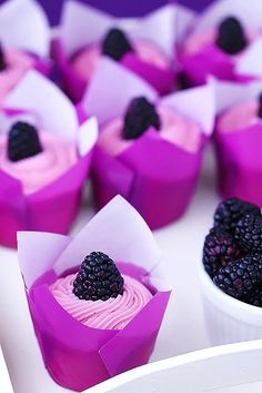 These multi-tonal purple cupcakes, topped with lush blackberries, are the perfect sweet treat for a bridal shower.